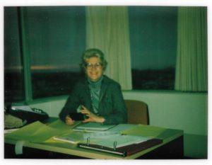 Maureen at her desk at Deloitte's